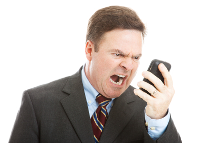 Angry Businessman Yelling into Phone